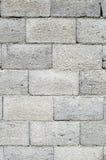 Wall of grey concrete blocks Stock Photo
