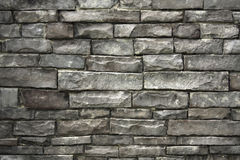 Wall of grey stacked stones Stock Images