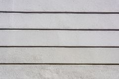 Wall with grooves. As a background Royalty Free Stock Image