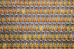 Wall of Guan Yin statues Stock Photos