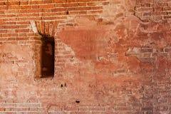 Wall with a gun loophole. Brick wall with a gun loophole Stock Photos