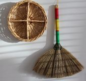Wall hangers. Brush and wicker tray on wall Stock Photography