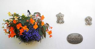 Wall hanging basket, with figured plaques. stock photos