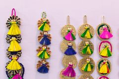 Wall hangings - handicrafts on display. Colorful decorative wall hangings, handicrafts on display with white background during the Handicraft Fair in Kolkata Royalty Free Stock Photography