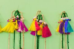 Wall hangings - jute made dolls, handicrafts on display. Colorful decorative wall hangings, dolls made of jute, handicrafts on display with white background Royalty Free Stock Photography