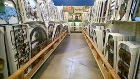 Wall hangings on shelves selling. Beautiful wall hanging  on shelves selling at the store Garden Ridge, USA Stock Photo