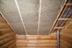 Wall heat isolation with mineral wool in wooden house, building under construction Royalty Free Stock Images