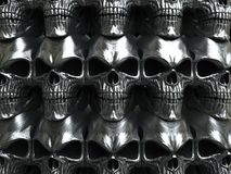 Wall of heavy metal skulls. Grim dark wall of heavy metal skulls Royalty Free Stock Photography