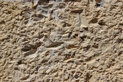 Wall hewn of natural rock. As a background Stock Images