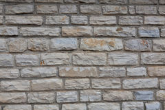 Wall of hewn natural stone Royalty Free Stock Photos