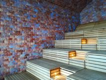 Wall of Himalayan salt bricks - sauna room indoor. Wall of Himalayan salt bricks and wooden benches - interior sauna room Stock Image