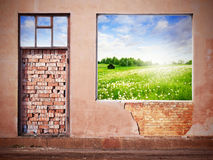 Wall with hole revealing green summer landscape Stock Images