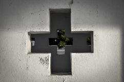The wall. The hollow cross on the wall with the blur green trees Royalty Free Stock Images