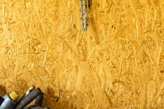 Wall in the home workshop of a wood particle Board. Royalty Free Stock Images