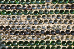 Wall of the house from bottles Stock Images