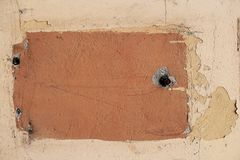 Colored wall of the house with cracks and old paint stock photos