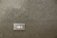 Electrical Sockets In Cement Wall of House stock images