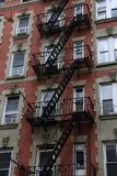 Wall of the house with fire stairs in downtown New York royalty free stock image