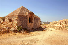 Wall and house in Firka fortress. At sun day, Crete Stock Photography