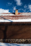 Wall of the house and icicles from the roof Royalty Free Stock Photos