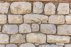 Wall of the house lined with stones Royalty Free Stock Photos