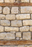 Wall of the house lined with stones Stock Photo