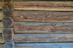 The wall of the house is made of logs. Royalty Free Stock Images