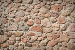 Wall of a house made of stones of different shapes and sizes Royalty Free Stock Photos