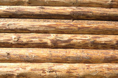 Wall of a house from planed horizontal logs as bac Stock Photo