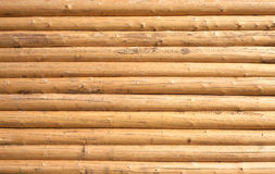 Wall of a house from planed horizontal logs as background Royalty Free Stock Photography