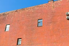 The wall of the house of red brick, Saint Petersburg, Russia. Stock Photo