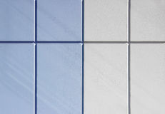 The wall of the house, trimmed with colorful panels, painted in bright colors. Blue and beige Stock Photos