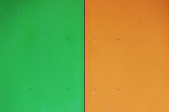 The wall of the house, trimmed with colorful panels, painted in bright colors. Green and orange. Royalty Free Stock Photography