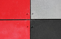 The wall of the house, trimmed with colorful panels, painted in bright colors. Grey, black and red.  stock photography