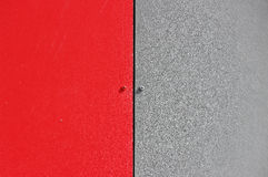 The wall of the house, trimmed with colorful panels, painted in bright colors. Grey and red.  royalty free stock image