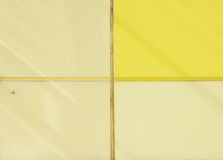 The wall of the house, trimmed with colorful panels, painted in bright colors. Yellow and beige Stock Photography