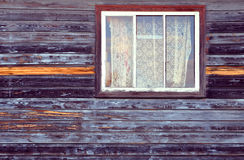 Wall of the house with window. Wall of the old wooden house with window stock photos