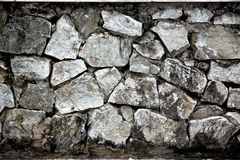 Wall houses is made ​​of old stone. Royalty Free Stock Photo