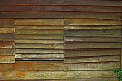 Wall of Hut Planks Old Wooden Background. Wall Hut Planks Old Wooden Background Texture Window Plant Green Brown Natural Travel stock photo