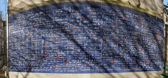 "The Wall of I Love You. Paris, France-November 28, 2016: In the Square Jehan Rictus in Montmartre, near Metro station Abbesses, you can see The Wall of Love "" Stock Photo"
