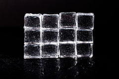 Wall of Ice cubes on black wet table. Selective focus Royalty Free Stock Image
