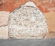 Wall with  immured arch passage, photo texture Stock Photos