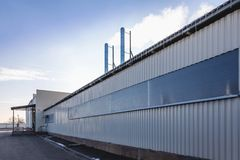Wall of industrial building with pipes Royalty Free Stock Photos