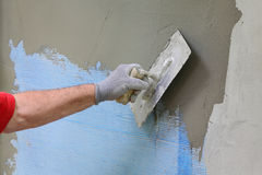 Wall insulation, spreading mortar over mesh Stock Image