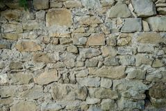 Wall of irregular placed stones. Textured background of irregular placed stones stock photo