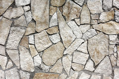 Wall irregular stones. Wall of irregular stones frontal Royalty Free Stock Photos