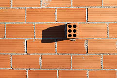 Wall with isolated brick. Red Brick Wall Pattern for Background or texture stock photo