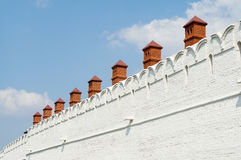 The wall of Kazan Kremlin. Ancient stone wall with red turrets Royalty Free Stock Photography