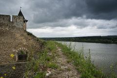 Wall of the Khotyn castle. Khotyn castle and river near the castle royalty free stock images