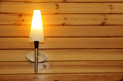 Wall lamp. Wooden houses in the center wall lamp Stock Photos
